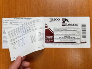 Agricultural chemical booklet hinge labels